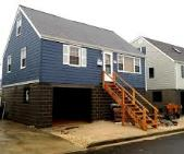 New Jersey home raised and placed on concrete foundation.